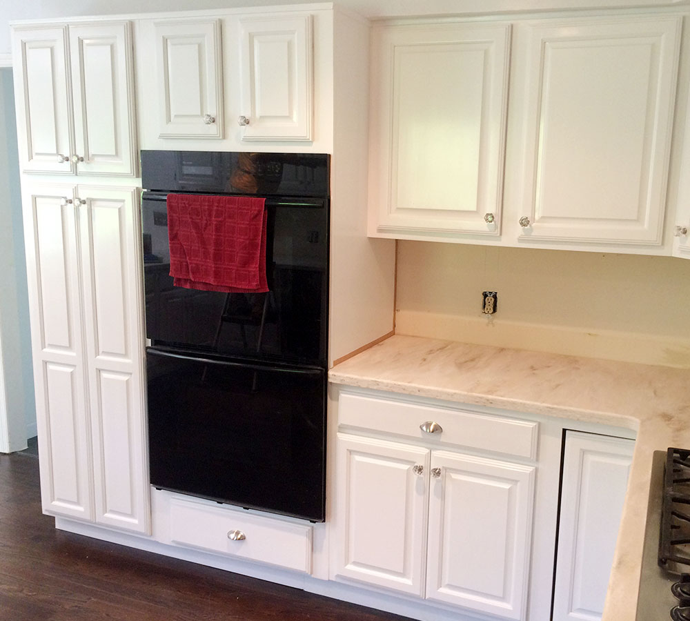 Maple Cabinets Sprayed In Pure White Tinted Lacquer